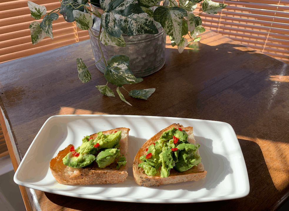 Avocado on toast at a sunny table