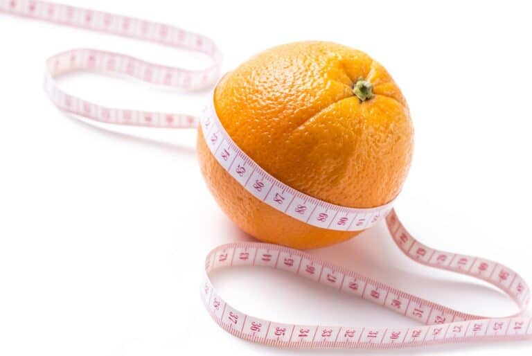 Orange with tape measure - losing weight