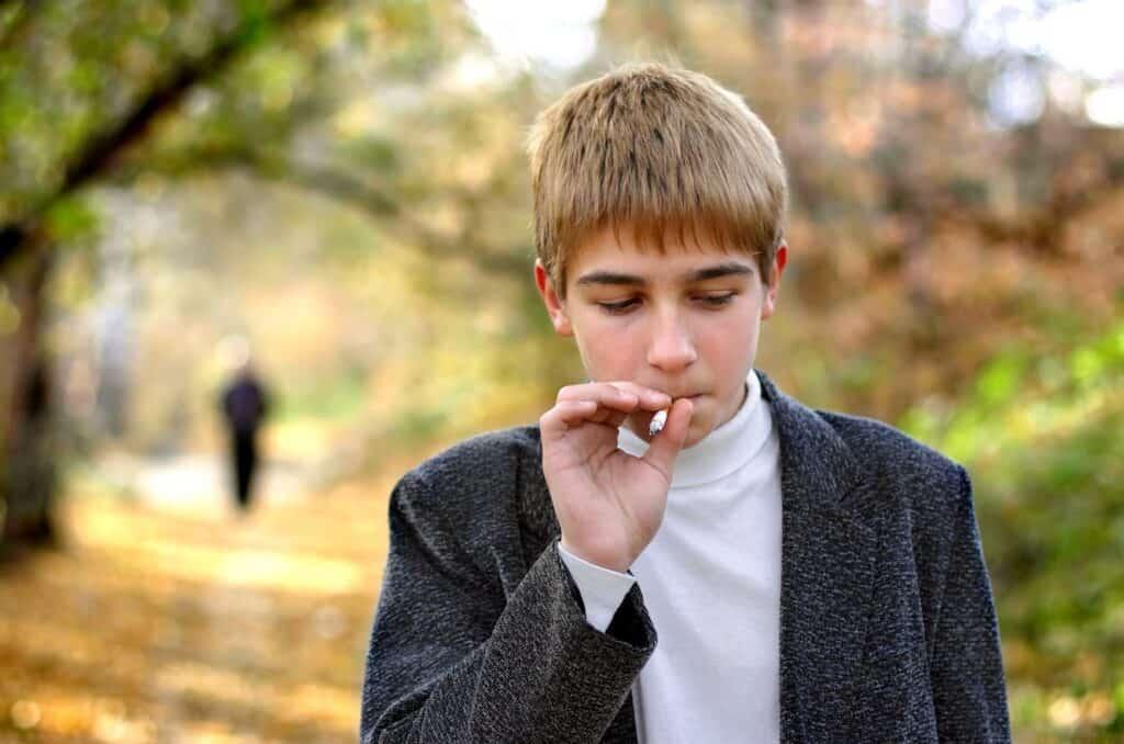 A teenager smoking