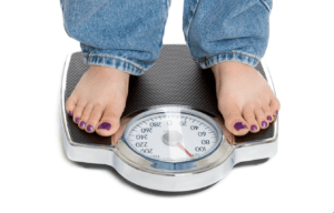 Losing weight standing on scale