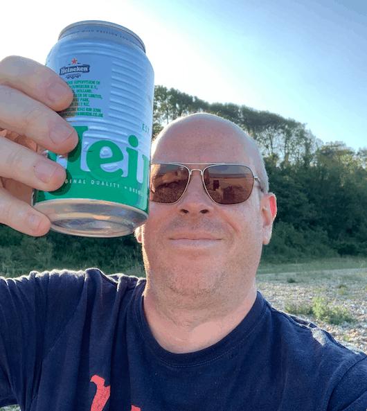 Photo taken drinking alcohol on a beach.
