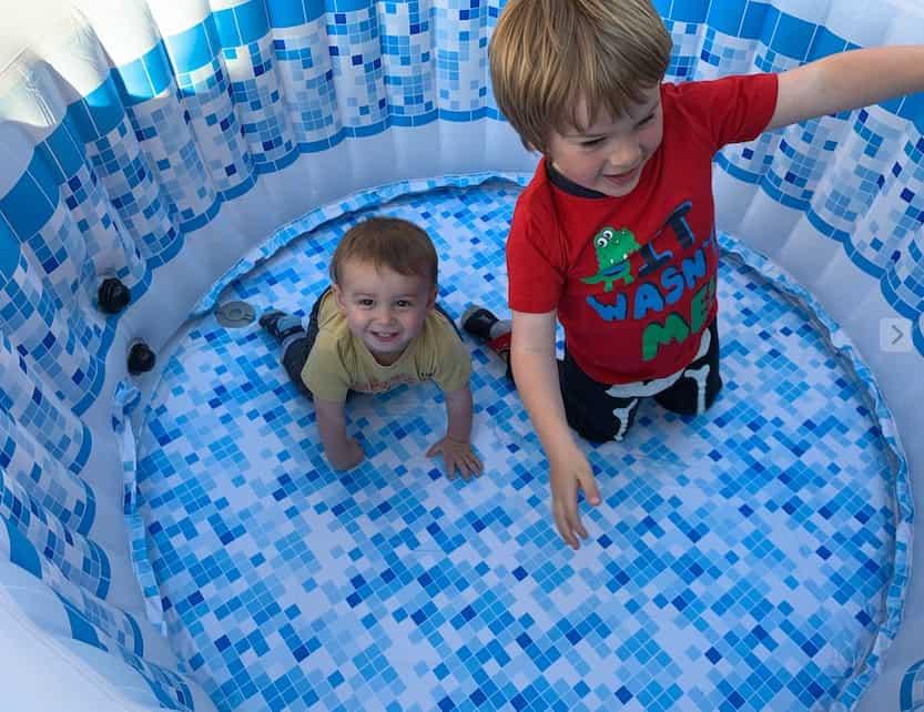 Children enjoying cleaning hot tub